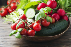 Mix of fresh vegetables on the wooden table. Selective focus Stock Photo