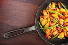 Mix of fried vegetables. On iron frying pan , upper view with copyspace Royalty Free Stock Image