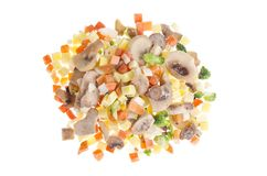 Mix of frozen cubes of vegetables with mushrooms stock images