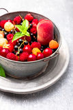 Mix fruit and berries in grey metal bowl. Close up. Mix fruit and berries in grey metal bowl. Close up Stock Image