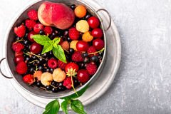 Mix fruit and berries in grey metal bowl. Top view. Mix fruit and berries in grey metal bowl. Top view Royalty Free Stock Photos
