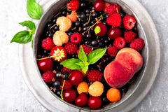 Mix fruit and berries in grey metal bowl. Top view. Royalty Free Stock Images
