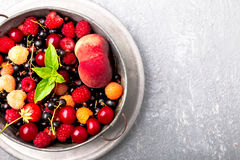 Mix fruit and berries in grey metal bowl. Top view. Stock Photo