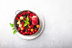 Mix fruit and berries in grey metal bowl. Top view. Royalty Free Stock Photo