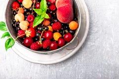 Mix fruit and berries in grey metal bowl. Top view. Mix fruit and berries in grey metal bowl. Top view Stock Photos