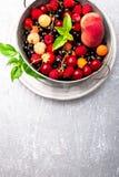 Mix fruit and berries in grey metal bowl. Top view. Mix fruit and berries in grey metal bowl. Top view Stock Image