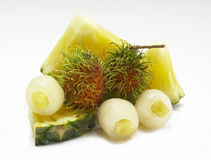 Mix fruit Pineapples,rambutan. Isolated-background Royalty Free Stock Photography