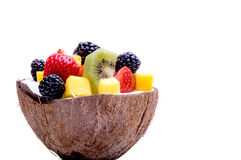 Mix fruit salad in a coconut bowl. Healthy concept. Mix of different fruits in a coconut bowl on a white background. Healthy concept royalty free stock photo