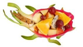 Mix fruit salad Served in creative  Dragon fruit, Pitaya rind bowl Stock Images