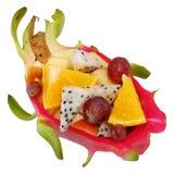 Mix fruit salad Served in creative  Dragon fruit, Pitaya rind bowl Stock Photography