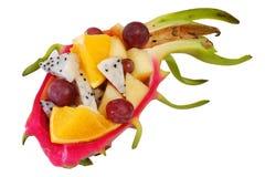 Mix fruit salad Served in creative  Dragon fruit, Pitaya rind bowl Royalty Free Stock Photo