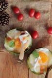 Mix fruit salad topping on tofu milk. Stock Photos