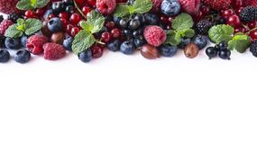 Mix fruits berries on white background. Ripe currants, raspberries, blueberries, gooseberrie, blackberries with a mint leaf. Sweet. And juicy fruits with copy Stock Images