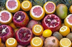 Mix of fruits. A mix of fruits containing pomegranate lemon,mangos and kiwis Royalty Free Stock Photography