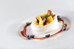 Mix Fruits dessert. A plate of fruits dessert made of strawberries, raspberry, mango and kiwi wrap in cream isolate on white Royalty Free Stock Photos