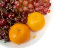 Mix 3 fruits. Orange grape and cherry Stock Image