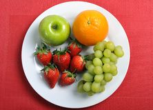Mix fruits on plate healthy nutrition concept Stock Photos