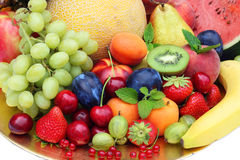 Mix of fruits and vegetables on golden plate. Royalty Free Stock Photography