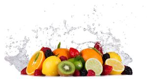 Mix of fruits with water splashes on white Royalty Free Stock Images