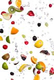 Mix of fruits with water splashes on white Royalty Free Stock Image