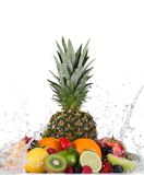 Mix of fruits with water splashes on white Stock Photos