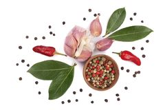 Mix of garlic, hot pepper, peppercorn and laurel leaf  on white background. Top view Stock Photos