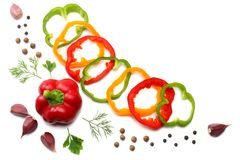 Mix of garlic, sliced sweet bell pepper and parsley  on white background. top view Stock Photos