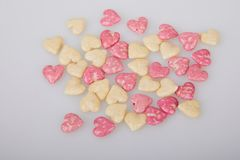 Mix of glazed, dry, pink and white heart shaped cereals breakfast. On white background stock images