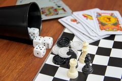 Variety table games on wooden background stock image