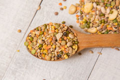 Mix from grain. Various seeds and grains on a wooden white table royalty free stock image