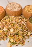 Mix from grain. Various seeds and grains on a wooden white table stock photos