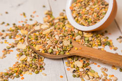 Mix from grain. Various seeds and grains on a wooden white table royalty free stock photo