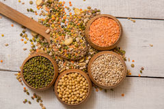 Mix from grain. Various seeds and grains on a wooden white table stock image