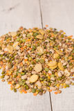 Mix from grain. Various seeds and grains on a wooden white table royalty free stock photos