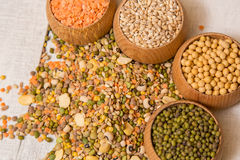Mix from grain. Various seeds and grains on a wooden white table stock photography