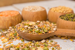 Mix from grain. Various seeds and grains on a wooden white table royalty free stock images