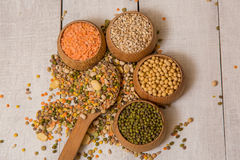 Mix from grain. Various seeds and grains on a wooden white table royalty free stock photography