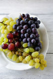 Mix grapes on white plate Royalty Free Stock Photo