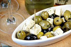 Mix of green and black olives on the table Royalty Free Stock Photo