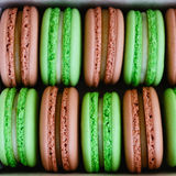 Mix of green and brown macaroon in a box Royalty Free Stock Image