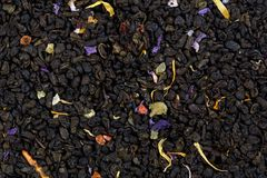 Mix green tea with pineapple, papaya, grapes, rose petals, marig. Old mallow blossoms Royalty Free Stock Image
