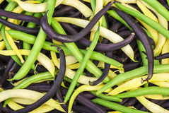 Mix of green, yellow and black wax beans. Abstract background: mix of green, yellow and black wax beans Stock Photo