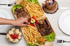 Mix grilled with meat, wine, fries potatoes Royalty Free Stock Photo