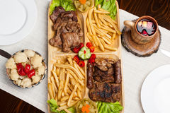 Mix grilled with meat, wine, fries potatoes Royalty Free Stock Photography