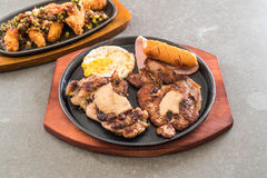 Mix grilled steak. On hot plate Stock Images