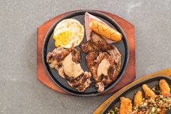 Mix grilled steak. On hot plate Royalty Free Stock Photography