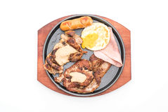 Mix grilled steak on hot plate Royalty Free Stock Photos