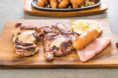 Mix grilled steak. On wood plate Royalty Free Stock Photos