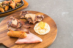 Mix grilled steak. On wood plate Stock Images