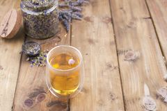 A mix of herbal tea with lavender, on a wooden background. Vintage photo. Free space for the text. Copy space stock photo